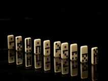 Dominoes on a black background Royalty Free Stock Image
