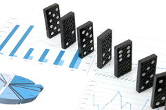 Dominoes on chart Royalty Free Stock Image