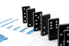 Dominoes on chart Stock Photography