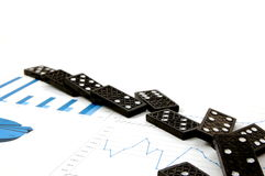 Dominoes on chart Royalty Free Stock Photography
