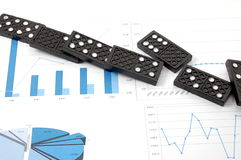 Dominoes on chart Stock Photos