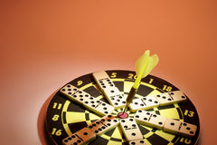 Dominoes on Dart Board Stock Photo