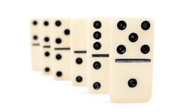 Dominoes. Domino effect - row of white dominoes isolated on white background Royalty Free Stock Photos