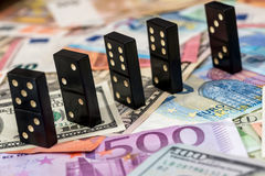 Dominoes on euro and dollar Stock Photos