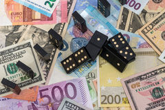 Dominoes on euro and dollar Royalty Free Stock Photography