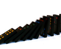 Dominoes falling. Down royalty free stock photo