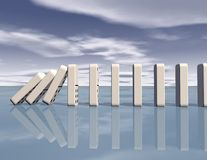 Dominoes falling with blue sky blue background Stock Image