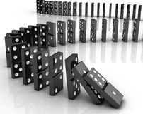 Dominoes falling Royalty Free Stock Photography