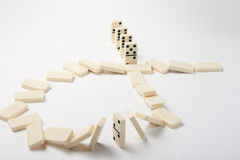 Dominoes. Game of dominoes, the fall of a piece due to the fall of all other Stock Images
