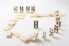 Dominoes. Game of dominoes, the fall of a piece due to the fall of all other Royalty Free Stock Photo