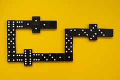 Dominoes game view from top on yellow background. Gambling board games royalty free stock photo