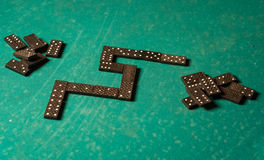 Dominoes on a green table Royalty Free Stock Photos