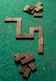 Dominoes on a green table Royalty Free Stock Image