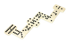 Dominoes lying in snake shape Stock Image