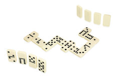 Dominoes lying in snake shape in game process Stock Photos