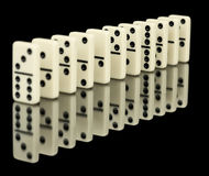 Dominoes ranked on black background Stock Images