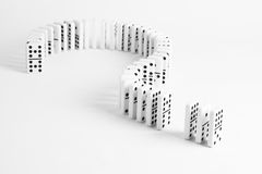 Dominoes in shape of question mark on plain background Royalty Free Stock Image
