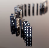 Dominoes standing on reflective surface Stock Photo