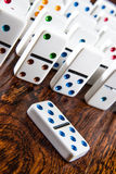 Dominoes Standing up on Wood Background with double 5 five Royalty Free Stock Images