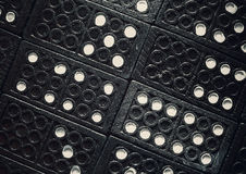 Dominoes Textures. Texture of black plastic dominoes, closeup view Stock Images