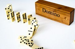 Dominoes on white background royalty free stock photos