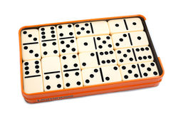 Dominoes. White dominoes inside their box on white background Royalty Free Stock Image