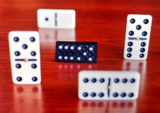 Dominoes on wooden board Royalty Free Stock Photos