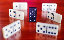 Dominoes on wooden board Royalty Free Stock Images