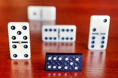 Dominoes on wooden board Royalty Free Stock Image