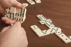 Dominoes on a wooden table. The game is tabletop. Dark background royalty free stock photos
