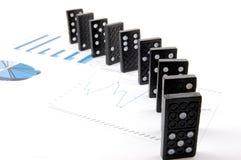 Dominos auf Diagramm Lizenzfreies Stockbild