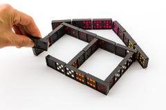 Dominos in der Haus-Form Stockfoto
