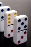 Dominos in einer Reihe Stockbild