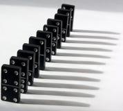 Dominos mit weißem Hintergrund Stockbild
