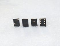 Dominos se tenant dans la neige Il valeur de 2016 Photo stock