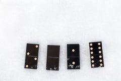 Dominos se trouvant sur la neige Il valeur de 2016 Image libre de droits