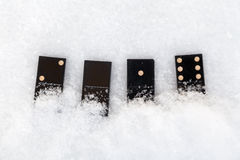 Dominos se trouvant sur la neige Il valeur de 2016 Photos stock