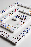 Dominos and stock report. Pattern of dominos on white royalty free stock image