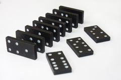 Dominos sur le fond blanc photographie stock libre de droits
