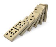 Dominos toppling Royalty Free Stock Photo