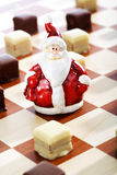 Dominostein Christmas pastry  with chocolate icing on chess boar Stock Photo
