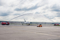 Domodedovo airport, Moscow - July 11th, 2015: Tupolev Tu-154M EW-85748 of Belavia Airlines greeted by water arch Royalty Free Stock Photos