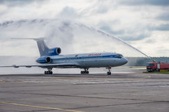 Domodedovo airport, Moscow - July 11th, 2015: Tupolev Tu-154M EW-85748 of Belavia Airlines greeted by water arch Stock Image