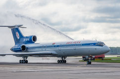 Domodedovo airport, Moscow - July 11th, 2015: Tupolev Tu-154M EW-85748 of Belavia Airlines greeted by water arch Stock Photo
