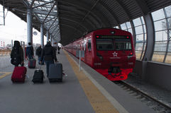 Domodedovo Airport, Moscow, Russian federal city, Russian Federation, Russia. Domodedovo, Russia, 23/04/2017: passengers departing with the red train of stock image