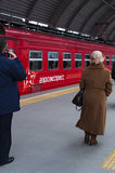 Domodedovo Airport, Moscow, Russian federal city, Russian Federation, Russia. Domodedovo, Russia, 23/04/2017: passengers departing with the red train of royalty free stock photography