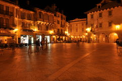 Domodossola, Italy. Lively Italian square at night. Royalty Free Stock Photography