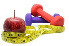 Domoor met het meten van band en rode appel Stock Afbeelding