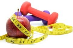 Domoor met het meten van band en rode appel Royalty-vrije Stock Foto