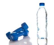 Domoren en fles zoet water Royalty-vrije Stock Afbeeldingen